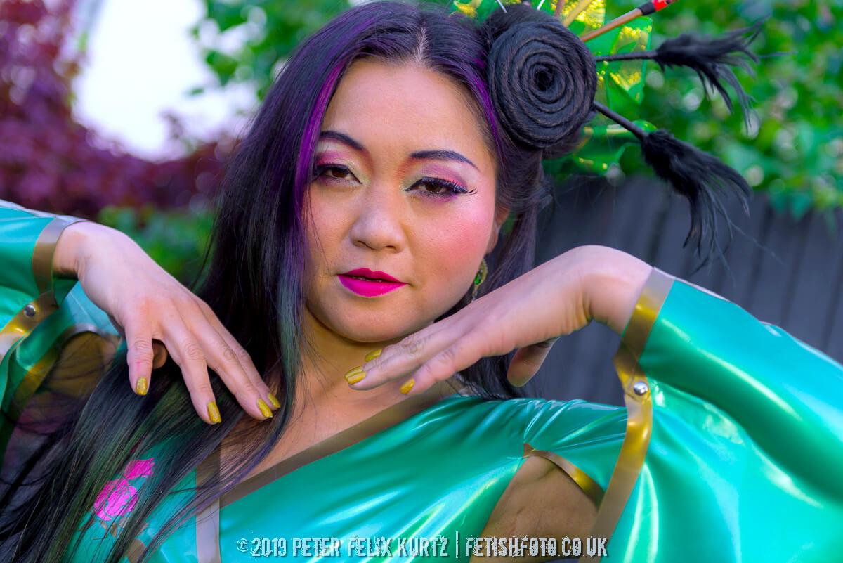 mistress amrita japanese fetish model wearing green latex bondinage kimono photo by peter felix kurtz
